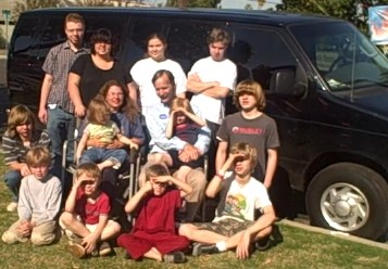 Our family in front of our new van