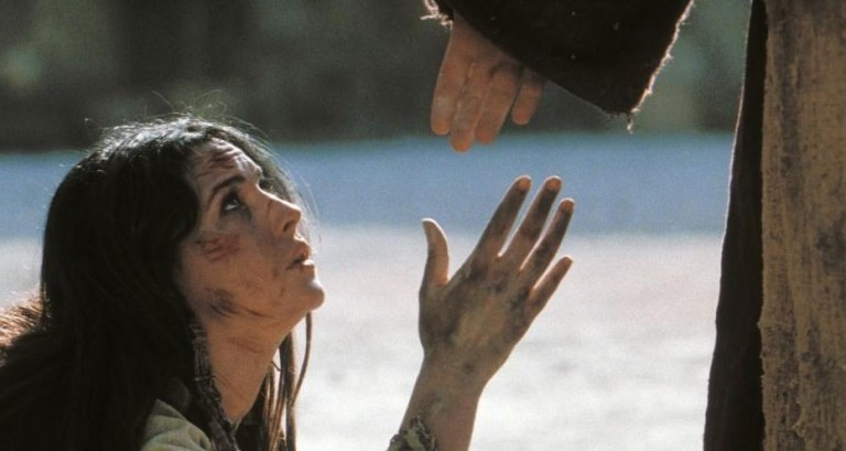 Jesus offers a hand up to the woman caught in adultery
