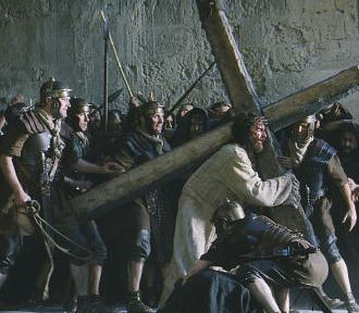 Jesus carries His cross in the Passion of the Christ movie