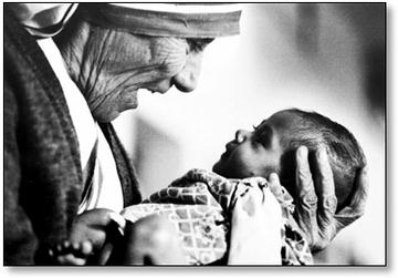 Mother Teresa of Calculla joyfully looks into the eyes of a child